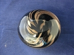 Swirled paperweight copper/black