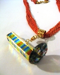 Detached Dichro4 kaleidoscope necklace by Lori Riley, Fiesta