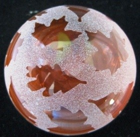 Frosted paperweight leaves orange